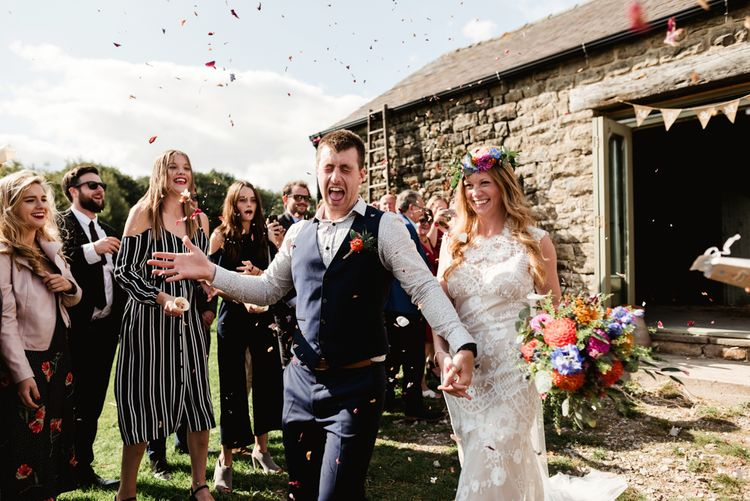 Confetti Exi t| Bride in Claire Pettibone Wedding Dress | Groom in Waistcoat | Colourful Outdoor Ceremony and Marquee Reception at Braisty Estate in North Yorkshire | The Lou's Photography