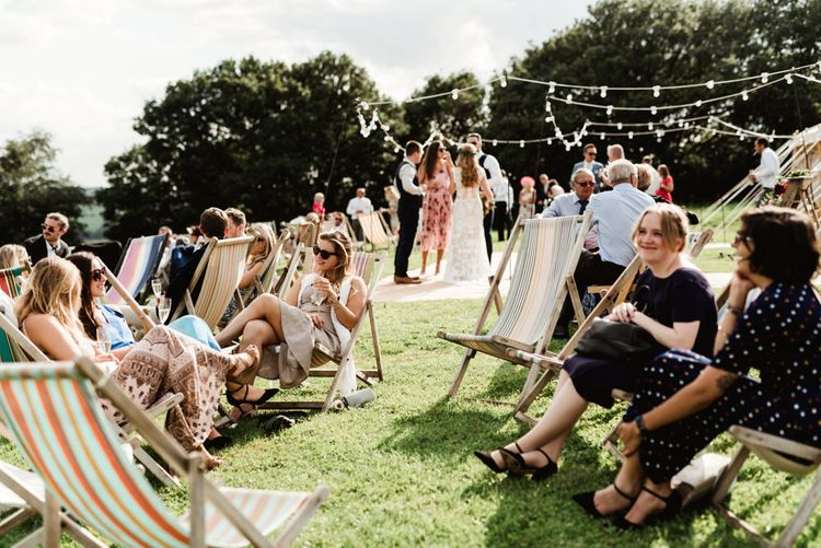 Deck Chair Seating Area | Colourful Outdoor Ceremony and Marquee Reception at Braisty Estate in North Yorkshire | The Lou's Photography
