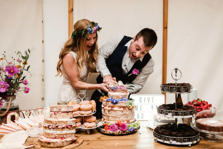 Cutting the Cake | Bride in Claire Pettibone Wedding Dress | Groom in Waistcoat | Colourful Outdoor Ceremony and Marquee Reception at Braisty Estate in North Yorkshire | The Lou's Photography