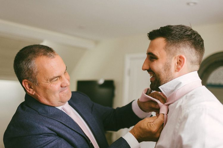 Groom having his Tie Fixed