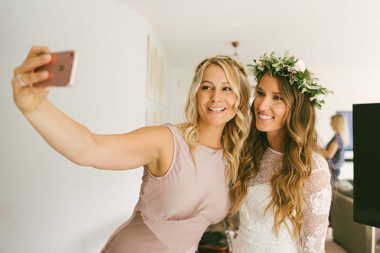 Bride and Bridesmaid Take a Selfie