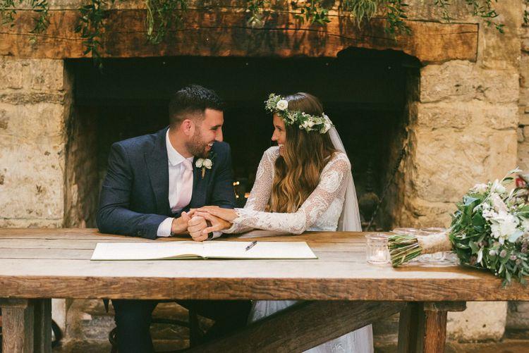 Bride and Groom Sign Wedding Register