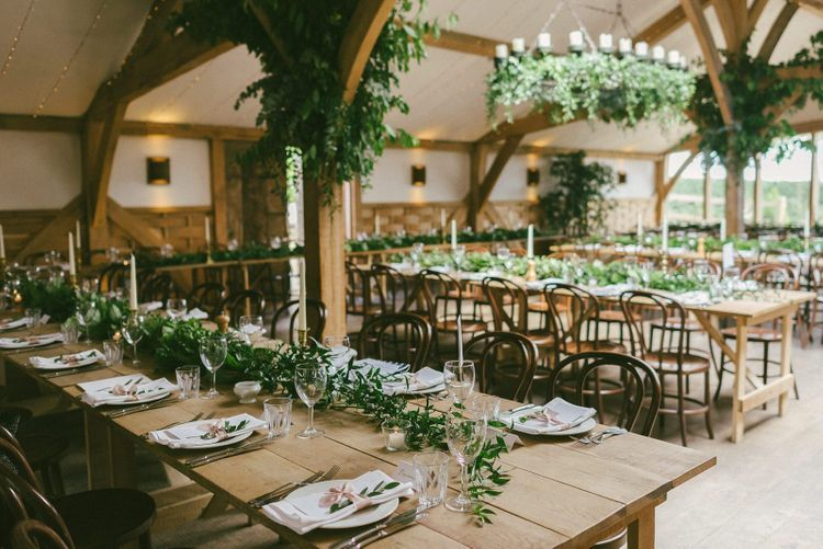Cripps Barn Wedding Venue Decorated with Foliage and Flowers