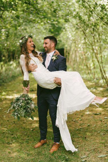 Groom Picks Up Bride Wearing Grace Loves Lace Wedding Dress