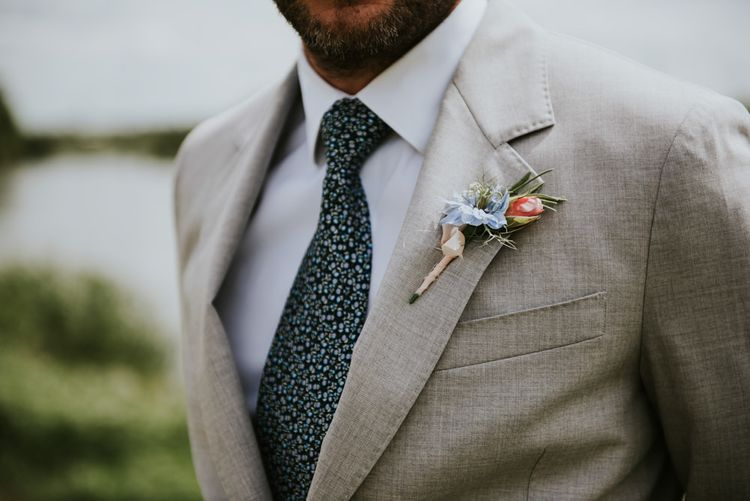 Groom in light blazer with buttonhole