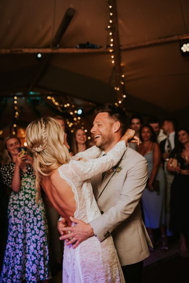 Bride and groom enjoy their first dance in tipi venue