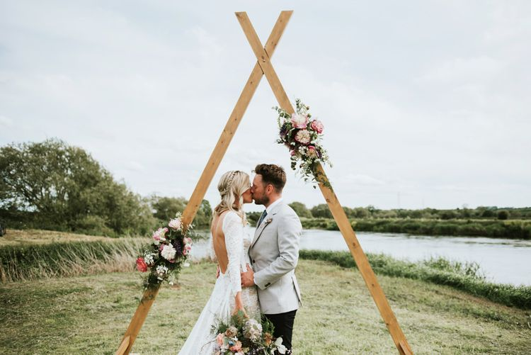 Wooden wedding decor with flower detail and wildflower bouquet