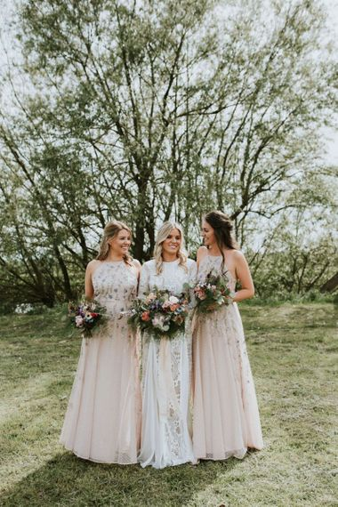 Floral bridesmaid dresses with wildflower bouquet