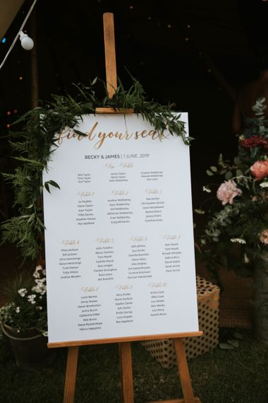 Wedding table plan with foliage decor