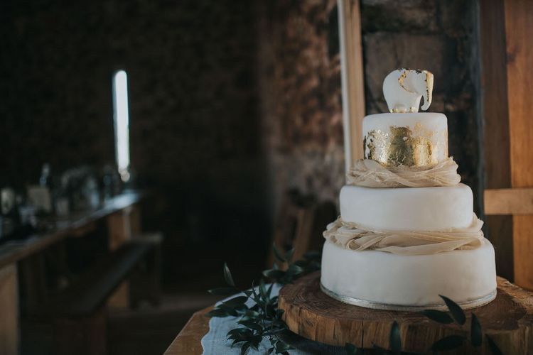 Gold And White Wedding Cake With Elephant Cake Topper / Image By Jo Greenfield Photographer