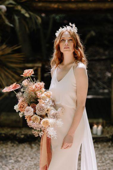 Bride in Thin Star Wedding Dress with Orange Flower Wedding Bouquet