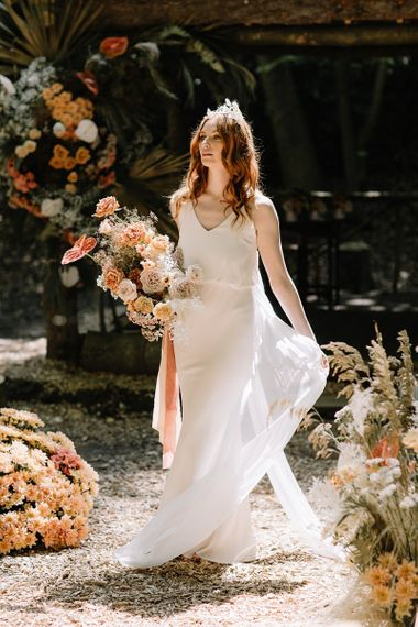 Beautiful Bride in Fitted Wedding Dress with Orange Flower Bouquet