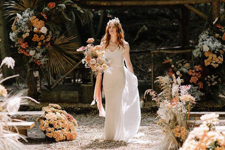 Bride in V Neck Wedding Dress at Woodland Wedding Ceremony
