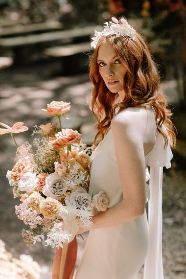 Natural Bridal Beauty Holding a Dried Flower and Orange Wedding Bouquet