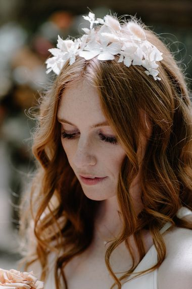 Natural Bridal Makeup with Wavy Hair and Delicate Flower Headdress