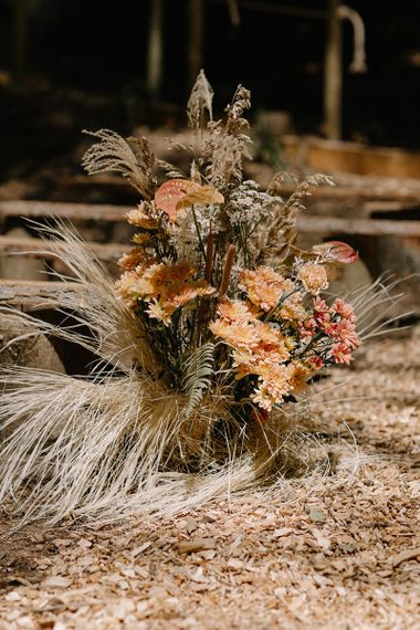 Wooden Benches and Floral Arrangements of Dried Grasses & Orange Flowers