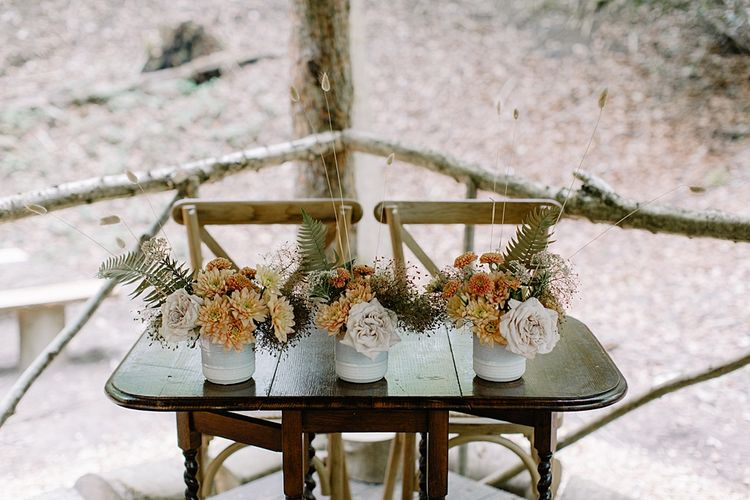 Orange and Dried Grass Wedding Flowers in Vessels