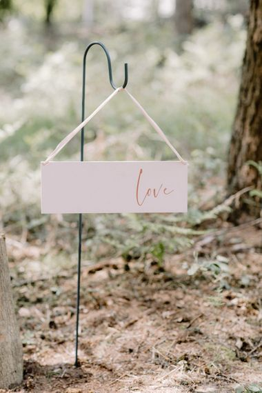 Hanging Love Sign Lining The Aisle