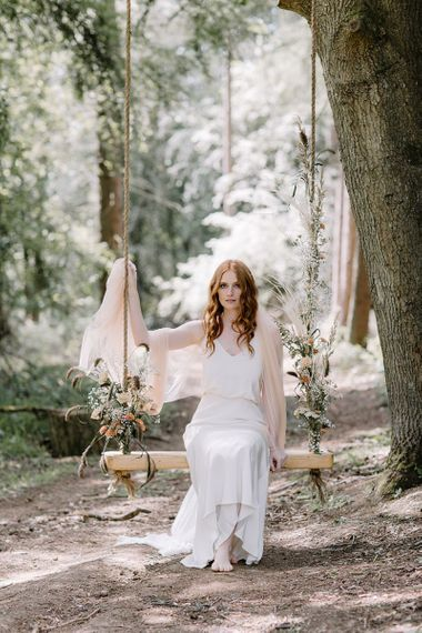 Whimsical Bride on a Swing Decorated with Flowers