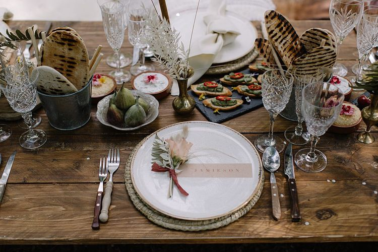 Low Wooden Table with Wicker Place Setting and Elegant Place Setting Card