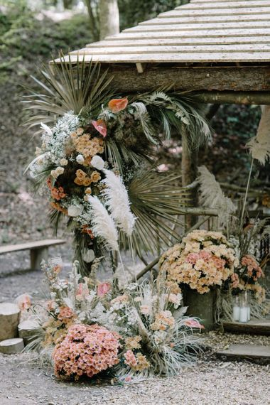 Floral Arrangement by JenniBloom Flowers with Pampas Grass, Dried Foliage and Orange Flowers