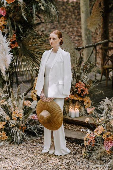 Stylish Bride with Sleek Bun Hairstyle, Fitted Wedding Dress and Blazer
