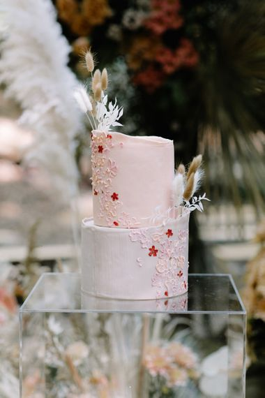 Blush Pink Two-Tier Wedding Cake with Delicate Piping