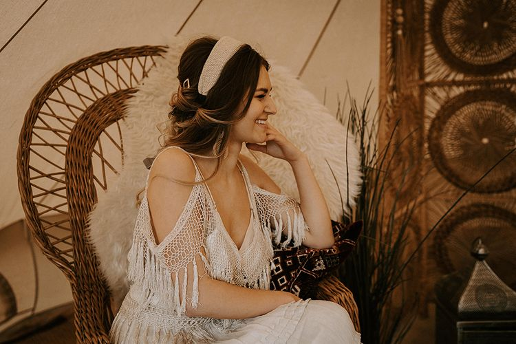 Boho Bride in Fringe Wedding Dress Sitting on a Wicker Chair