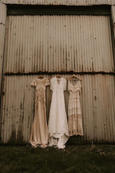 Three Boho Wedding Dresses hanging Up with Lace and Fringe Detail