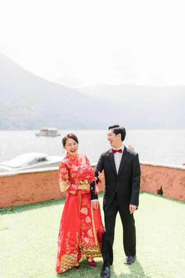 Chinese Tea Ceremony Wedding Bride in Traditional Chinese Red Dress and Groom in Black Tuxedo