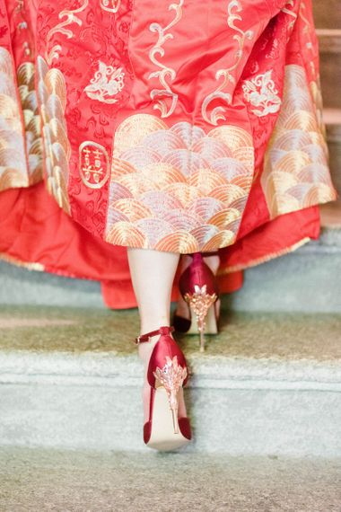 Chinese Tea Ceremony Wedding Bride in Traditional Chinese Red Dress and Red and Gold Shoes