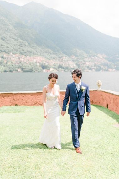 Bride in Fitted Anna Kara Wedding Dress and Groom in Navy Suit