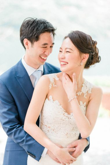 Laughing Bride in Fitted Anna Kara Wedding Dress and Groom in Navy Suit