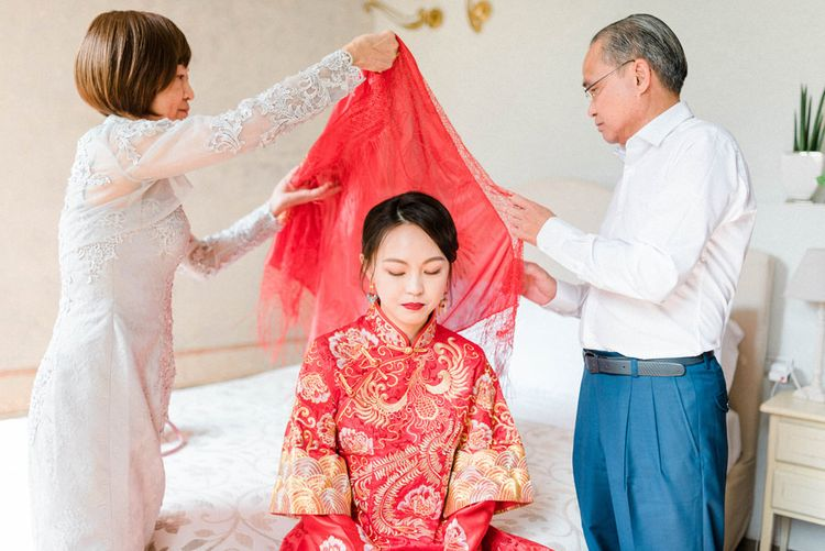 Bride in Traditional Chinese Red Dress with Parents