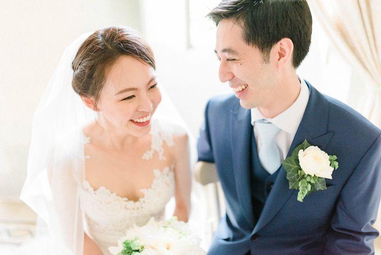 Happy Bride in Anna Kara Wedding Dress and Groom in Three-piece Navy Wedding Suit