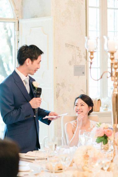 Groom in Three-piece Navy Wedding Suit Giving His Wedding Speech