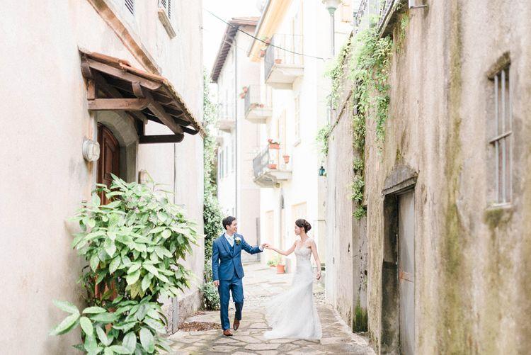 Bride in Anna Kara Wedding Dress and Groom in Three-piece Navy Wedding Suit