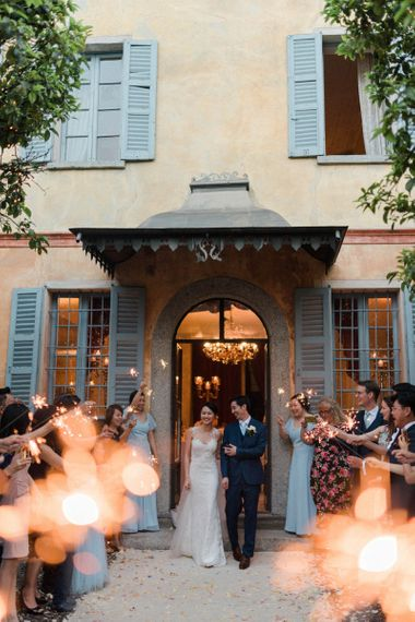 Sparkler Exit with Bride in Anna Kara Wedding Dress and Groom in Three-piece Navy Wedding Suit