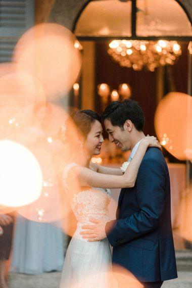 Sparkler Moment with Bride in Anna Kara Wedding Dress and Groom in Three-piece Navy Wedding Suit