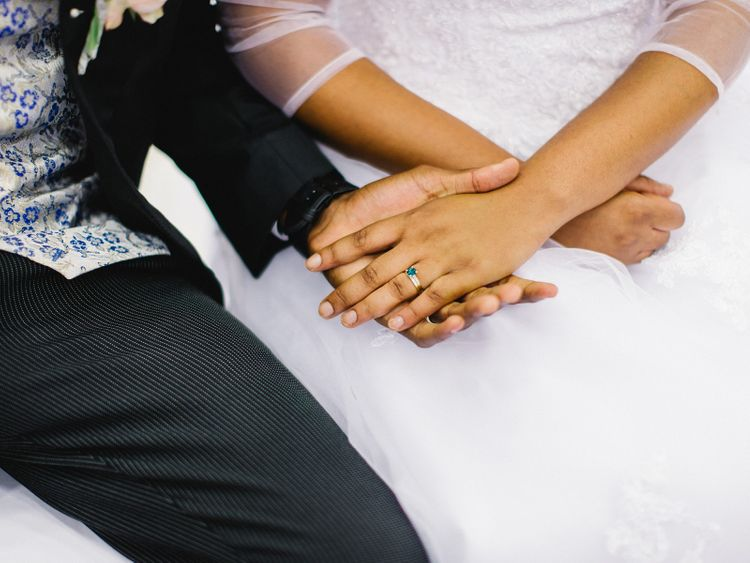 Bride and Groom Hold Hands Curing Wedding Ceremony