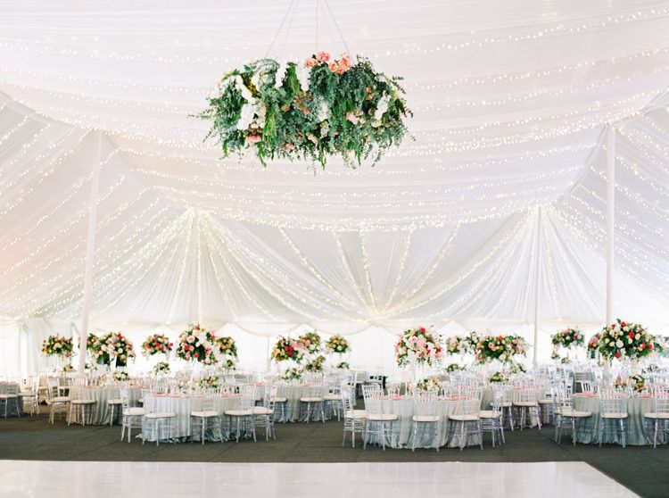 Flower Chandelier and Fairy Lights In Marquee