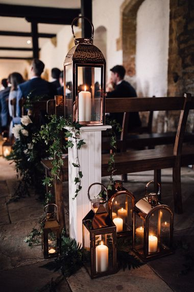 Lanterns And Foliage For Wedding Aisle Decor // Image From Samuel Docker Photography