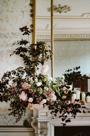 Floral Installation For Wedding On Fireplace // Image By John Barwood Photography