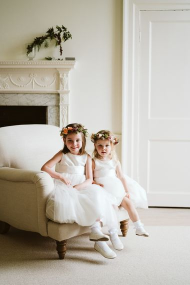 Flower Girls In White Dresses With Flower Crowns // Image By John Barwood Photography