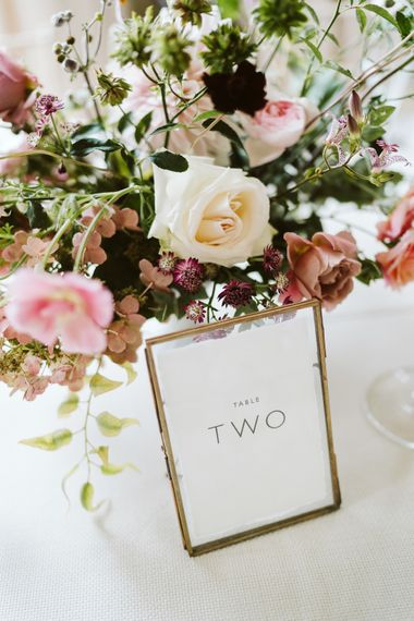 Table Numbers In Gold Frames // Image By John Barwood Photography