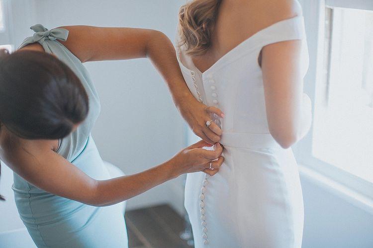 Wedding Morning Bridal Preparations | Bride in Suzanne Neville Bardot Nouveau Wedding Dress | Pastel Pink & Mint Green Wedding at Granary Estates Suffolk | Julia & You Photography