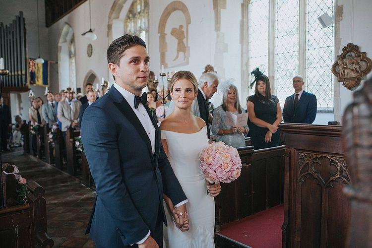 Church Wedding Ceremony | Bride in Suzanne Neville Bardot Nouveau Wedding Dress | Groom in Black Tie | Pastel Pink & Mint Green Wedding at Granary Estates Suffolk | Julia & You Photography