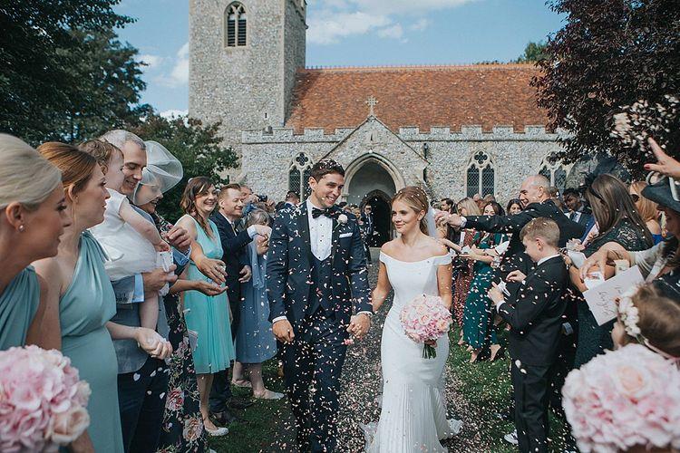 Church Confetti Moment | Bride in Suzanne Neville Bardot Nouveau Wedding Dress | Groom in Black Tie | Pastel Pink & Mint Green Wedding at Granary Estates Suffolk | Julia & You Photography