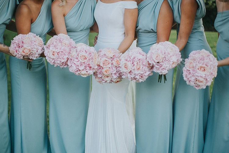 Bridal Party Pink Rose Bouquets | Bridesmaids in Mint Green One Shoulder Vivie-Grace by Jayde Spicer | Bride in Suzanne Neville Bardot Nouveau Wedding Dress | Pastel Pink & Mint Green Wedding at Granary Estates Suffolk | Julia & You Photography
