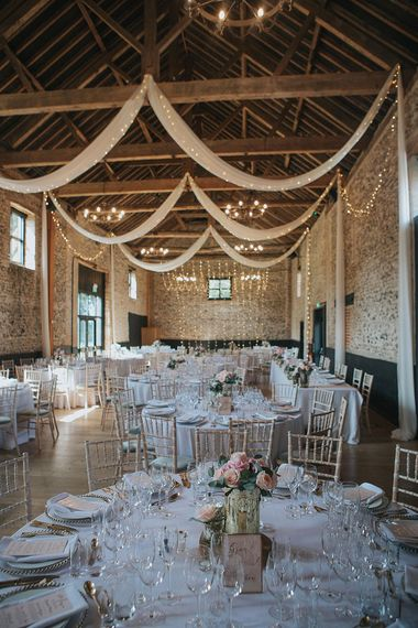 Fairy Lights & Drapes Wedding Reception Decor | Pastel Pink & Mint Green Wedding at Granary Estates Suffolk | Julia & You Photography